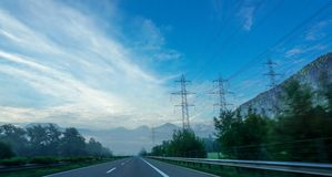 Motorway in the morning in the alps during driving a car. Mai 2017 royalty free stock image