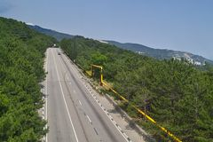 Motorway in mountain forest Stock Photography