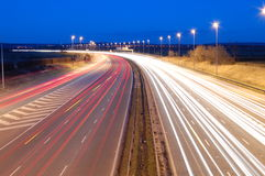Motorway At Night. Motorway just as it goes dark with traffic travelling at speed in both directions Stock Images