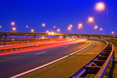 Motorway at night. Cars breaking on an overpass of a motorway at night Stock Photo