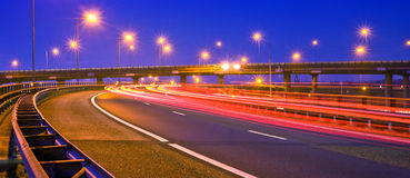 Motorway at night. Cars breaking on an overpass of a motorway at night Royalty Free Stock Photos