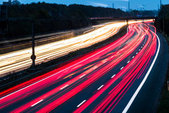 Motorway at night with fast moving cars Stock Photos