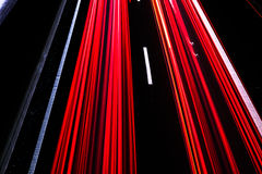 Motorway at night with fast moving cars Royalty Free Stock Photo