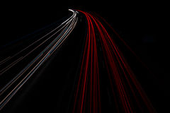 Motorway at night with fast moving cars Royalty Free Stock Image