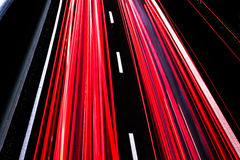 Motorway at night with fast moving cars Stock Photo