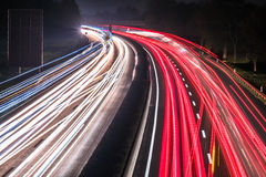 Motorway at night with fast moving cars Royalty Free Stock Photos