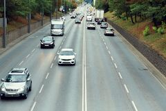 Motorway out of city. going cars on the road. Motorway out of city. going cars on the road stock photography
