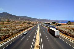 Motorway. Panoramic view of a three-lane motorway near the sea coast royalty free stock photos