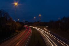 Motorway with Ramp at Dusk with Car Lights stock photography