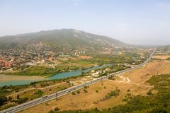 Motorway and river near the town of Mtskheta. Georgia stock image