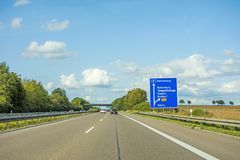 Freeway road sign on Autobahn A81, Herrenberg - Rottenburg. Motorway road sign on Autobahn 81 / A 81 / E 531 showing way to city Herrenberg - exit Rottenburg / Royalty Free Stock Images