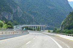 The A23 motorway runs through the Alps. Italy royalty free stock photos