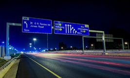 Motorway Signs on Highway at night. Johannesburg, South Africa - October 24 2011: Motorway Signs on Highway at night royalty free stock photo