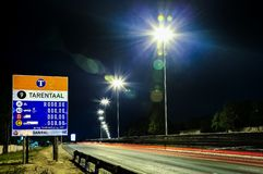 Motorway Signs on Highway at night. Johannesburg, South Africa - October 24 2011: Motorway Signs on Highway at night royalty free stock images