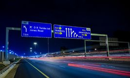 Motorway Signs on Highway at night. Johannesburg, South Africa - October 24 2011: Motorway Signs on Highway at night royalty free stock image
