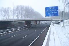 Motorway A20 during snow at the cordlandt aquaduct and the junction Nieuwerkerk aan den IJssel in the Netherlands. stock photo
