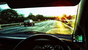 Motorway sunset. Gritty shot from car on motorway Stock Photography