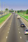 Motorway traffic. Motorway/freeway (three lanes) with not too much traffic royalty free stock photos