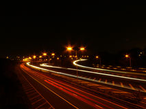 Motorway traffic light trails. Lines of motorway traffic light trails at night time Stock Photography