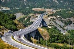 Motorway traffic. Traffic passing through a motorway bridge Stock Image