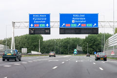 Motorway A1 with traffic and route signs, Amsterdam, Netherlands. Traffic on motorway interchange A1-A10 and overhead route information signs, Amsterdam, North royalty free stock photos