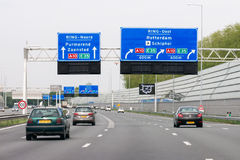 Motorway A1 with traffic and route signs, Amsterdam, Netherlands Stock Photography