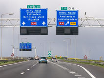 Motorway A4 with traffic and route signs, The Hague, Netherlands. Traffic on motorway A4 and overhead route information signs, The Hague, South Holland stock photo
