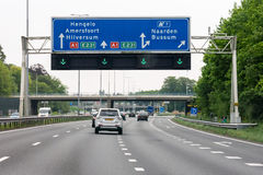 Motorway A1 with traffic and route signs, Naarden, Netherlands royalty free stock photo