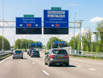 Motorway A12 with traffic and route signs, Utrecht, Netherlands stock images