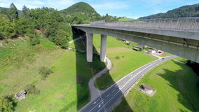 Motorway under the bridge and highway road. Aerial lifting up close up shot of a motorway road with traffic under the bridge and highway road with cars and truck stock video footage