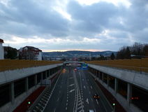 Motorway under a cloudy sky. Photo of a road under a cloudy sky Stock Photos