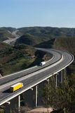 Motorway with yellow and white trucks. Aerial view of motorway with yellow and white truck stock images