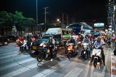 Motos en cruces en la noche en Tailandia Imagen de archivo libre de regalías