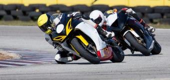 Mototbikes che corre sulla pista Immagine Stock