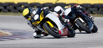 Mototbikes Racing on Track. Two racing motorcycles on a sharp bend Stock Image
