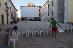 Motovun, Croatia - July 27, 2015: Preparations for evening projection on main Motovun square at Motovun film festival. royalty free stock images