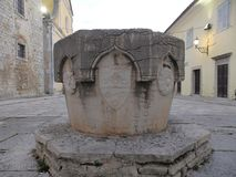 Motovun Montona - well on the Andrea Antico Square stock images