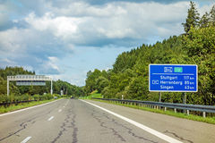 Freeway road sign on Autobahn A81. Motoway road sign on Autobahn 81 / A 81 / E 531 showing way to city Stuttgart, Herrenberg and Singen Stock Images