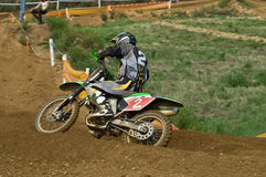 Motox. Motocross pilot in action at race Royalty Free Stock Photography