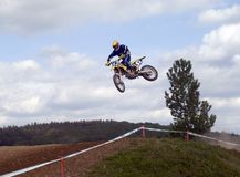 MotoX Jump. Going over a table Stock Images