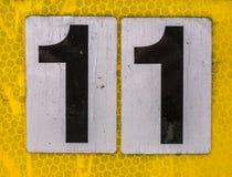 Mots écrits dans l'état affligé numéro trouvé par typographie 11 onze Photographie stock
