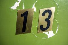 Mots écrits dans l'état affligé numéro trouvé par typographie treize 13 Images stock