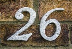 Mots écrits dans l'état affligé numéro trouvé par typographie 26 vingt-six Photo stock