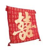 Mots chinois de double bonheur sur un oreiller Photographie stock
