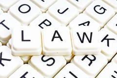Mots croisé de mot des textes de loi La lettre d'alphabet bloque le fond de texture de jeu Caractères gras de cubes alphabétiques Image libre de droits
