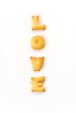 Mots d'amour par un biscuit de b c Photographie stock