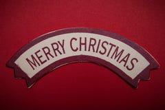 Mots de Joyeux Noël sur la bannière Photographie stock libre de droits