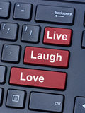 Mots de Live Laugh Love sur le clavier Photos stock