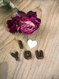 Mots secs JE T'AIME roses et de chocolat Photo stock