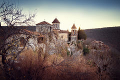 Motsameta Monastery. Is a small and very beautiful monastery with round turrets crowned with peaked tent-shaped domes. The monastery is standing above the rough Royalty Free Stock Image